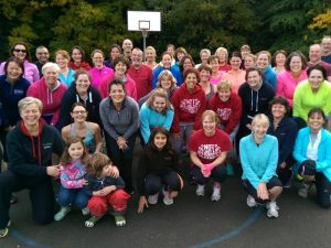 Group of happy healthy FastTrack Fit Camp members who exercise outdoors