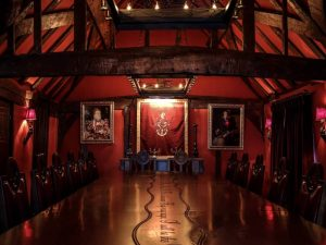 The dramatic red private dining room at the Hinds Head Bray