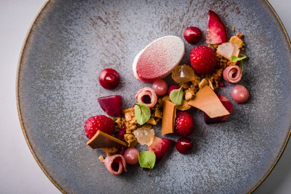 L'Ortolan Head Chef Tom Clarke's raspberry pudding on a handmade grey plate