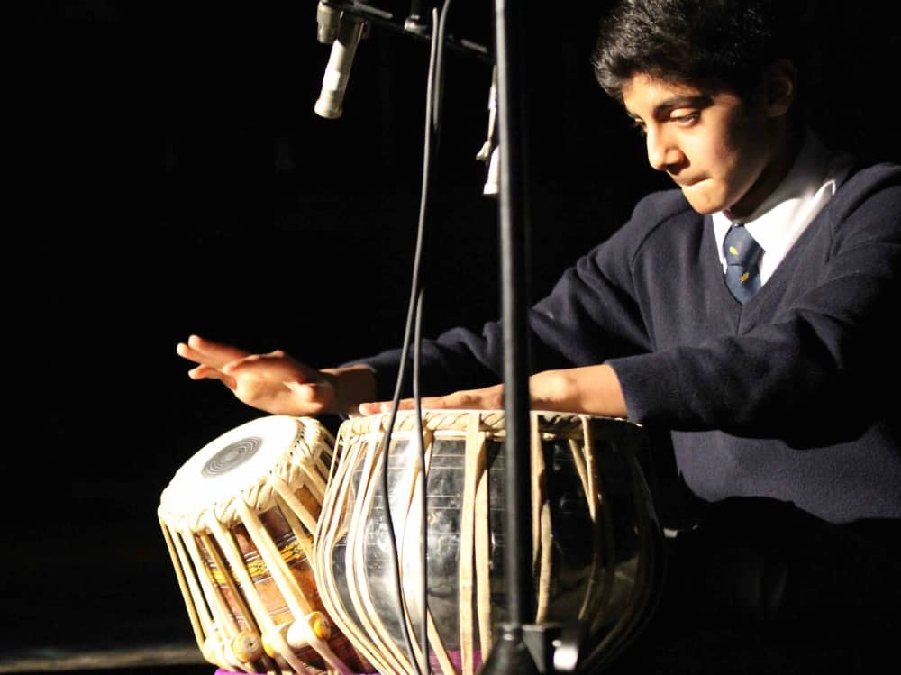 Leighton Park School Reading Berkshire boy playing bongos