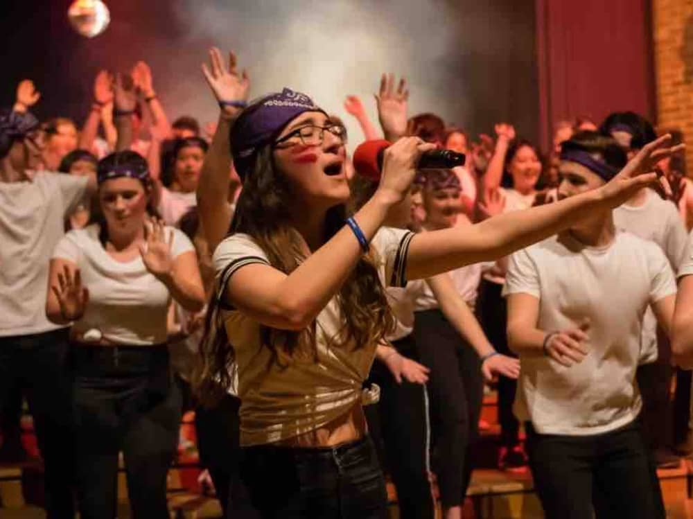 Leighton Park School Reading Berkshire teenagers perform House production singing and waving arms in white t shorts and baseball caps