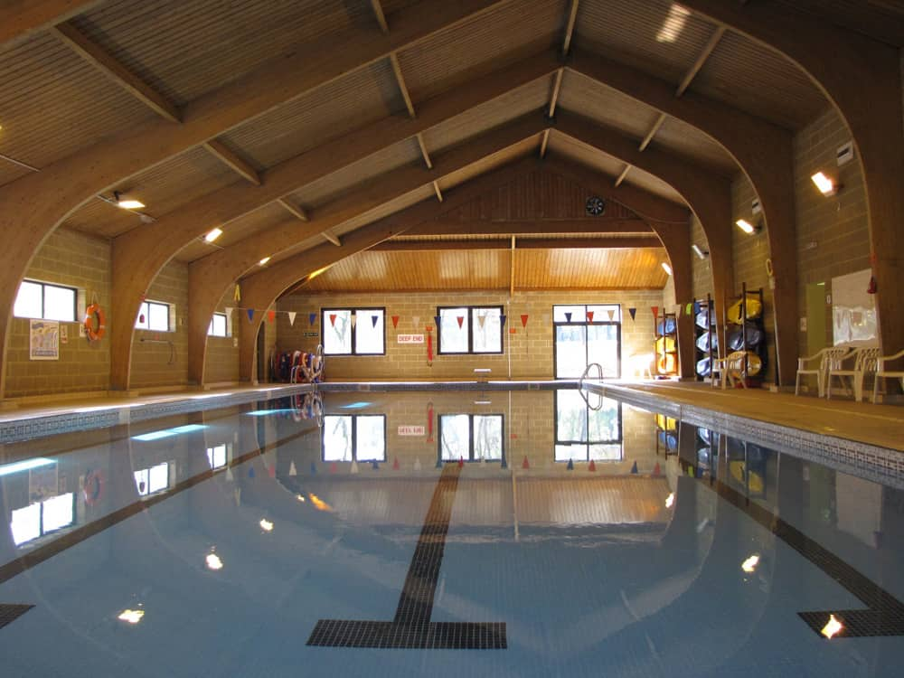 Leighton Park School Reading Berkshire 25m indoor pool with wood panelled ceiling and sides