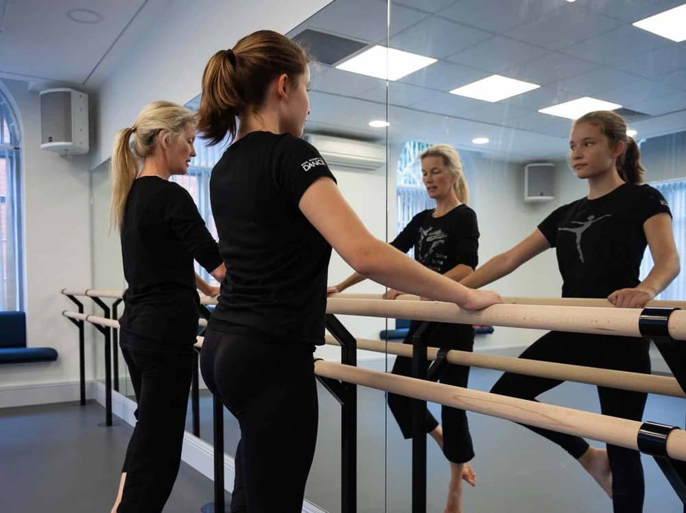Leighton Park School Reading Berkshire Dance Studio barre, matters two students stretching