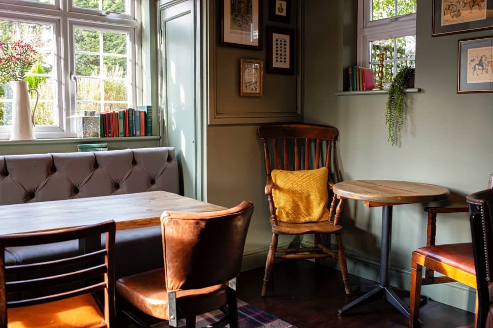 Golden Ball Pub Pinkneys Green banquette and vintage oak chairs with mustard cushion