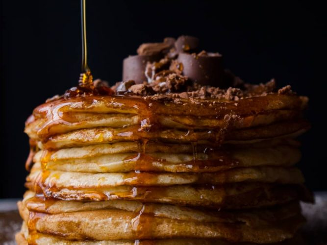 Pancake stack with maple syrup and chocolate topping