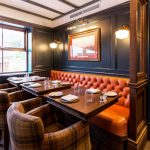 Oxford Blue Old Windsor – Tan button backed banquette with plaid tweed chairs