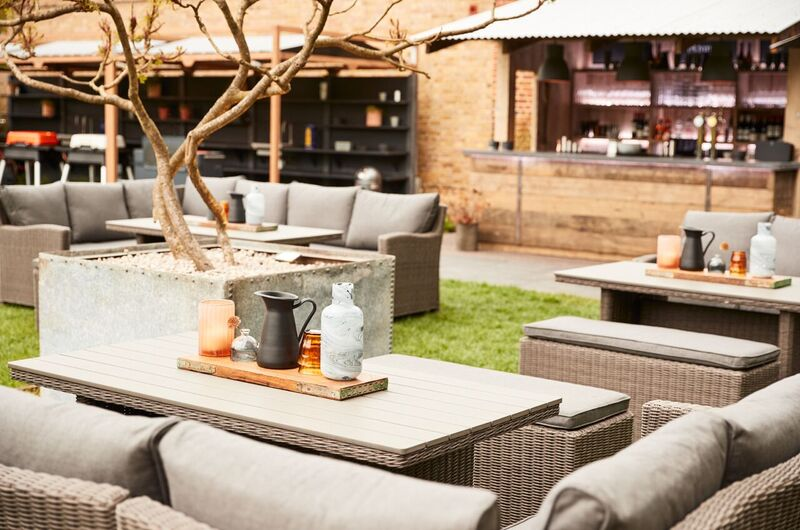 Crown at Bray Heston Blumenthal gastropub Berkshire pub garden with comfy seating and fire pit