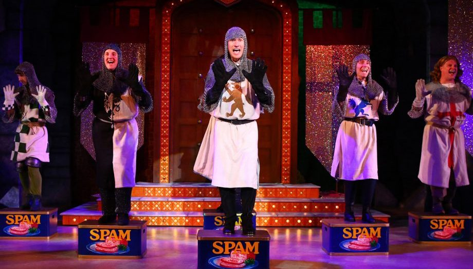 Monty Python musical Spamalot with knights performing on tins of Spam