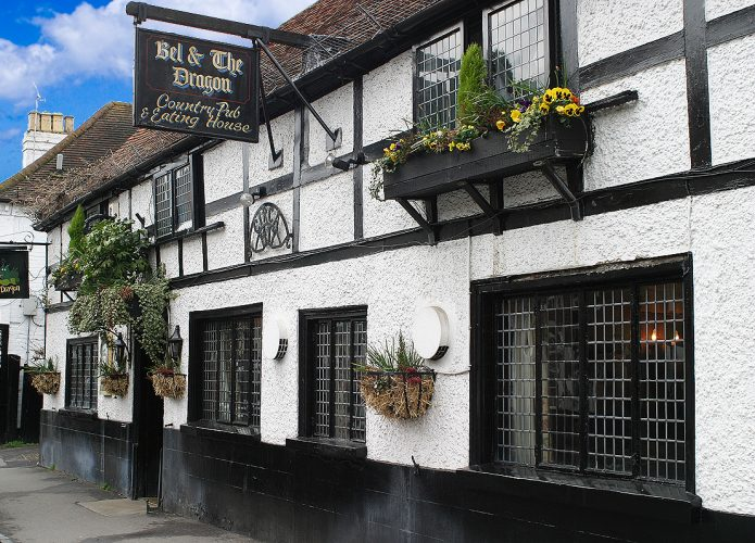 White rendered black timber frame building of Bel and The Dragon Cookham – Best Places to Live Muddy Stilettos Berkshire