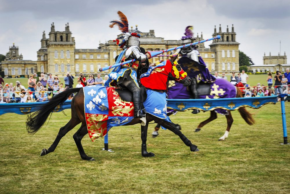 Horses and riders jousting outside the spectacular Blenheim Palace