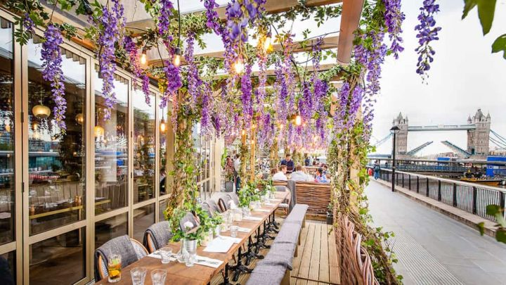 outside benches and rails covered by floral cabanas on the river thames London