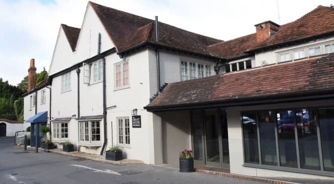white rendered large hotel with tiled rook and grey frame windows at the Great House Hotel in Sonning