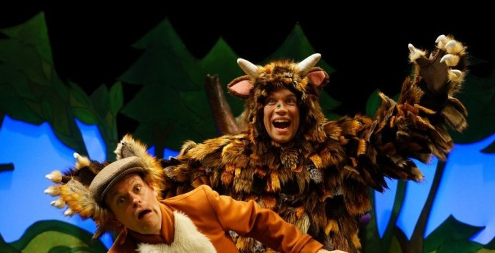 Stage show of The Gruffalo, actor dressed as made up monster with the actor playing the fox