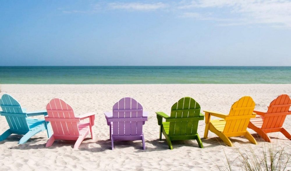 white sands, blue sea and a rainbow of chairs to sink into and relax