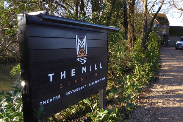 Sign at the entrance of the Mill at Sonning theatre by the tree-lined river