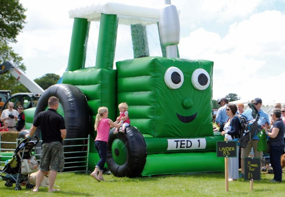 Giant inflatable bouncy castle of Tractor Ted at Stonor Park, Henley
