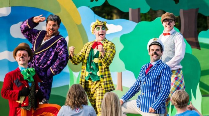 Outdoor theatre Wind in The Willows with Toady in a yellow tartan suit and cap, Ratty, Badger and Mole