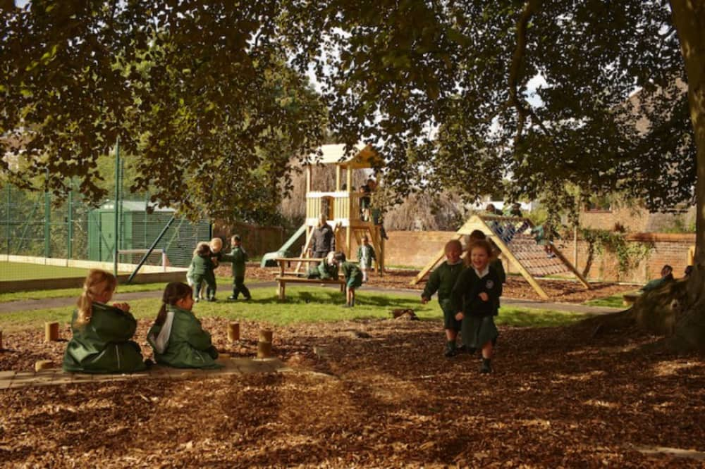 Abbey School Reading outdoor play area with climbing frame and fort for the Junior School pupils