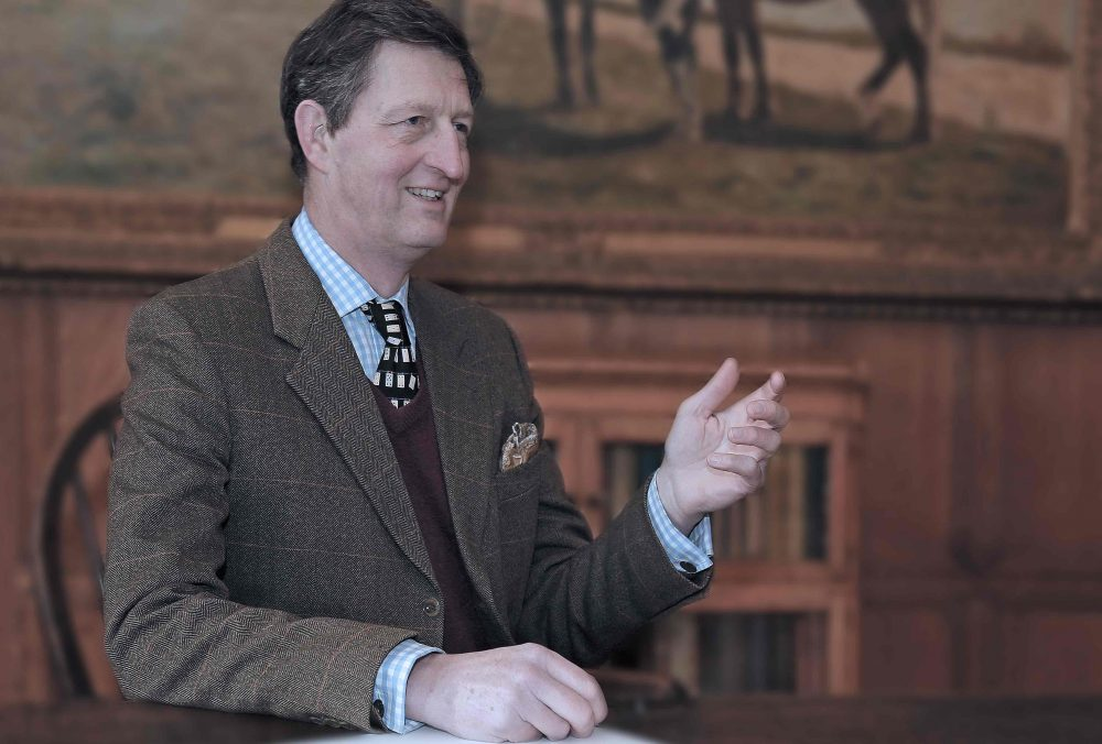 Brockhurst Headteacher David Fleming in his signature check and tweed, sat in the impressive wood panelled hall ate the school