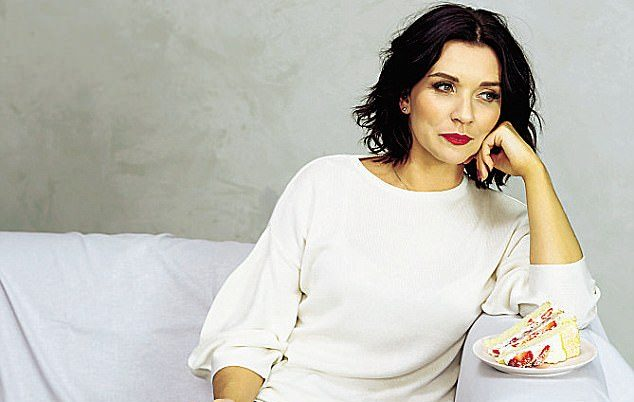 BBC Great Brith Bake Off winner wearing her signature red lipstick and a cool cream jumper