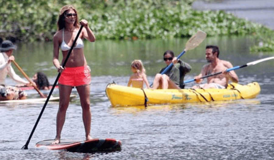Actress Jennifer Aniston paddle board ion awake with a family canoeing