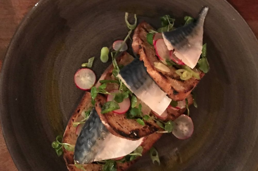 sliced mackerel on soda brea with radish and watercress salad