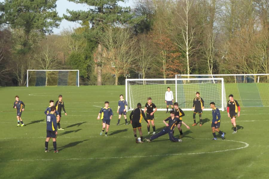 Boys playing football on the pitches at Reading Blue Coat