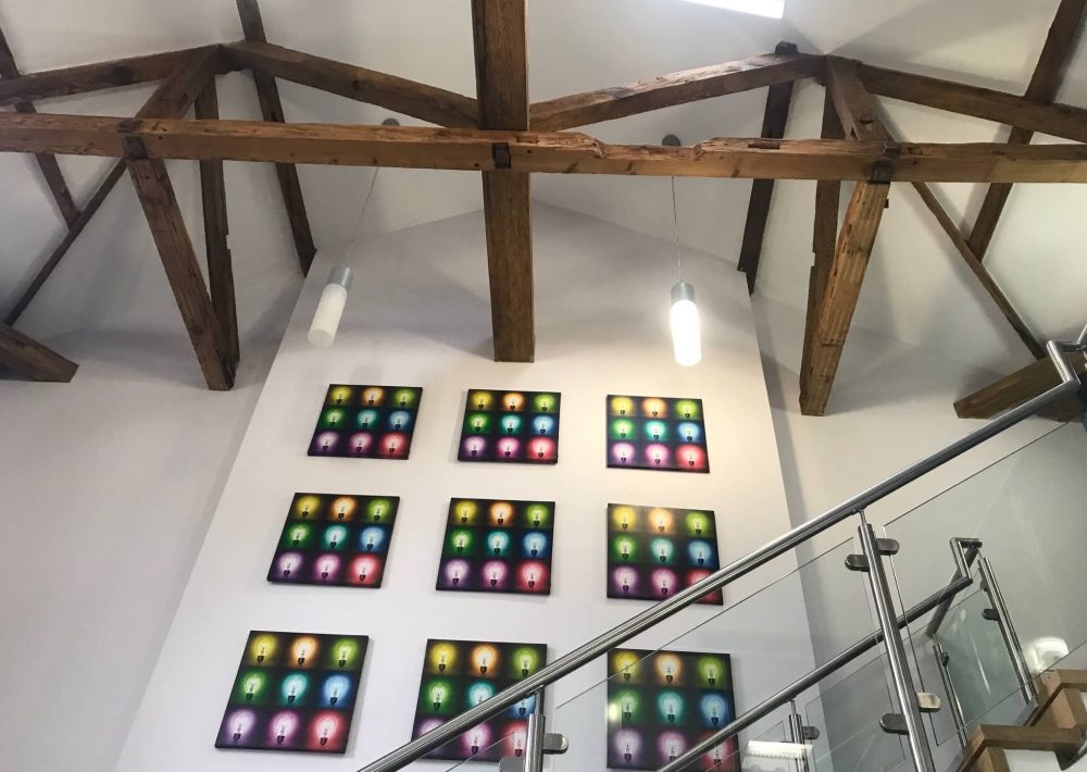 Lightbulb prints adorn the whole walls of an old Reading Blue Coat School building with exposed oak beams