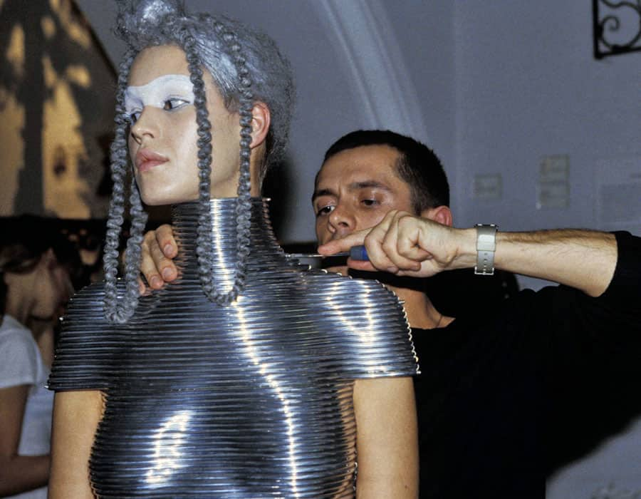 A model wearing a silver corset moulded to her body by jewellery designer Shaun Leane for the Alexander McQueen show
