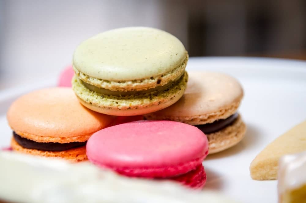 The Real Macaron Company macarons pink ornage green and cream coloured