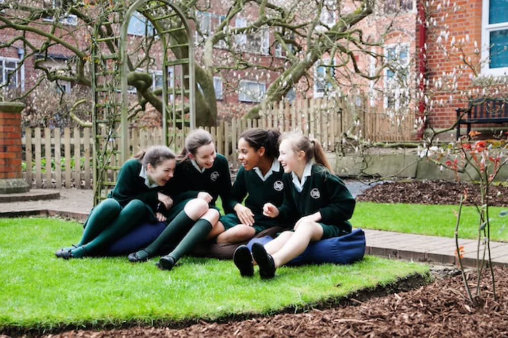 The Abbey School in Reading girls hang out own the limited outdoor space