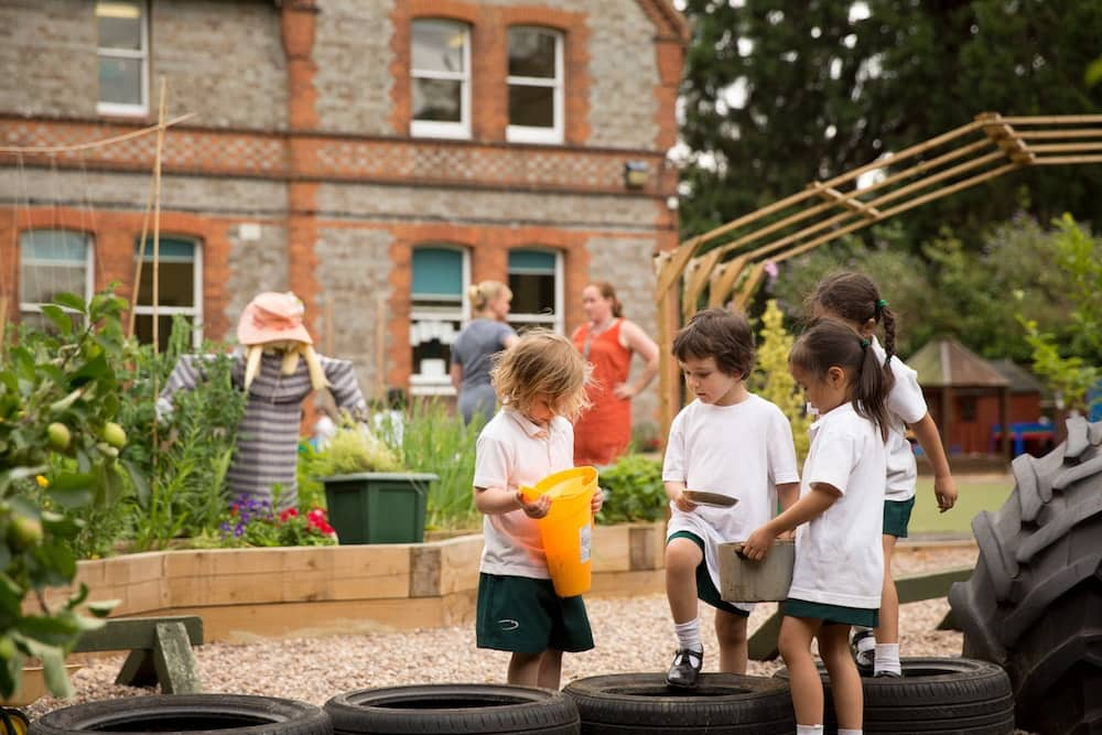 The Abbey in Reading Junior School children play outside and help in the kitchen garden