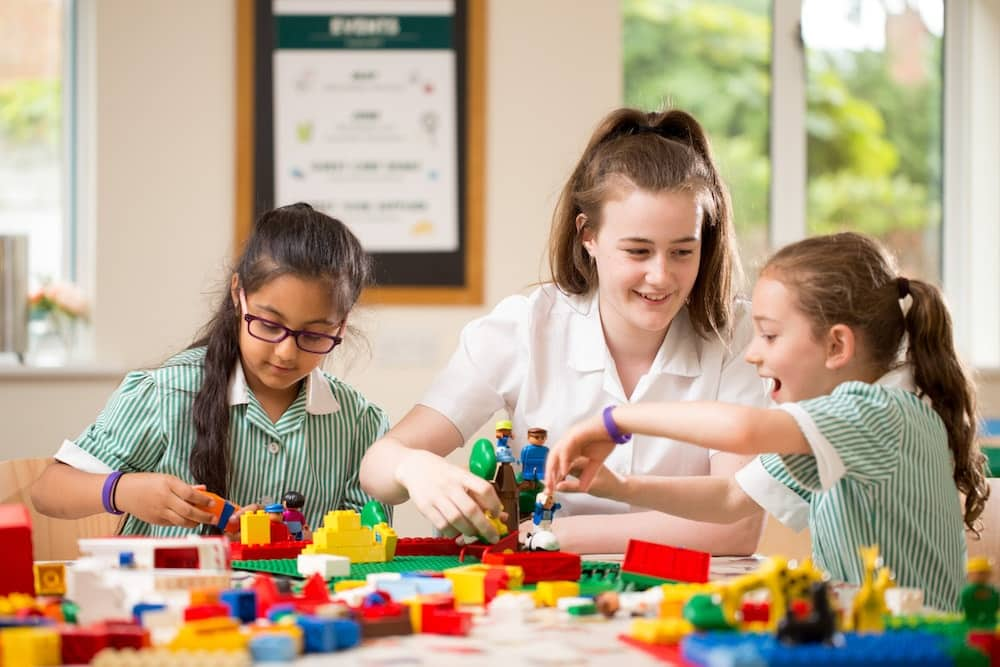 Abbey School pupils in Reading playing with lego during one of the many clubs