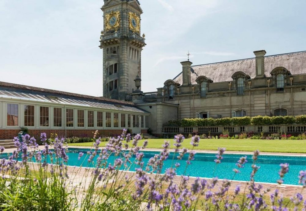 The clock tower tower over the iconic 'Profumo' grade II listed outdoor pool at Cliveden Hotel and Spa