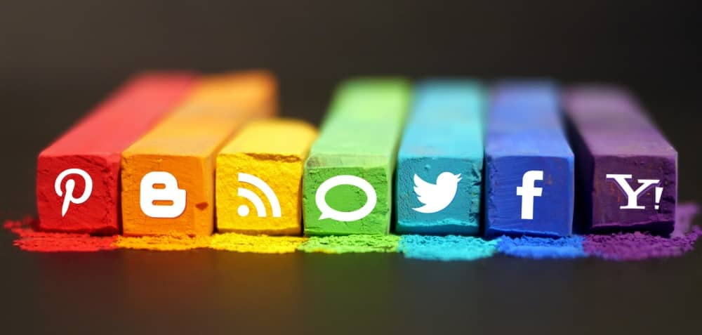 social media icons set in a rainbow of chalk