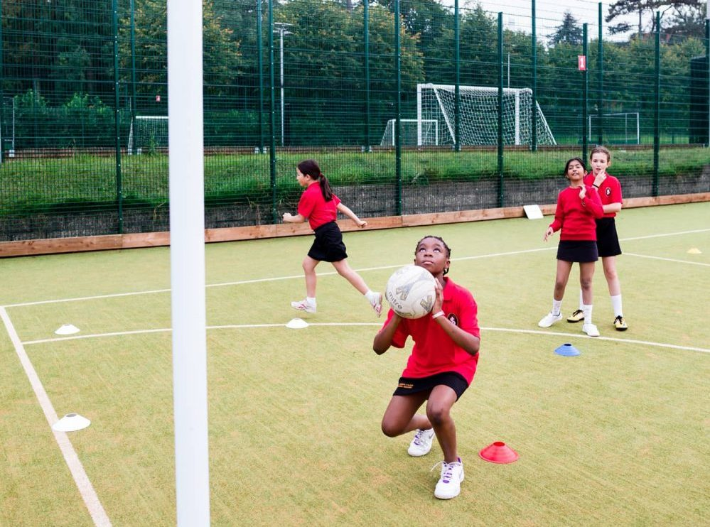 Netball played on the astroturf pitches of St Joseph's College Reading