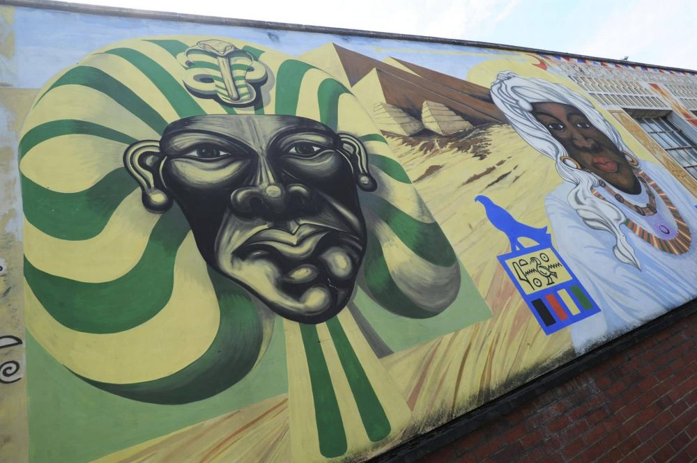 Urban street art in Reading Berkshire of a black man portrayed as a pharaoh - symbolic of Reading's black community