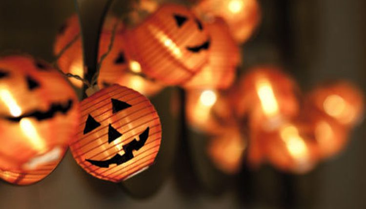 Garland of fairylights string with Pumpkin carved faces in