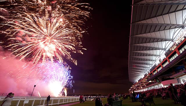 fireworks exploding in front of the grandstand at Ascot Racecourse