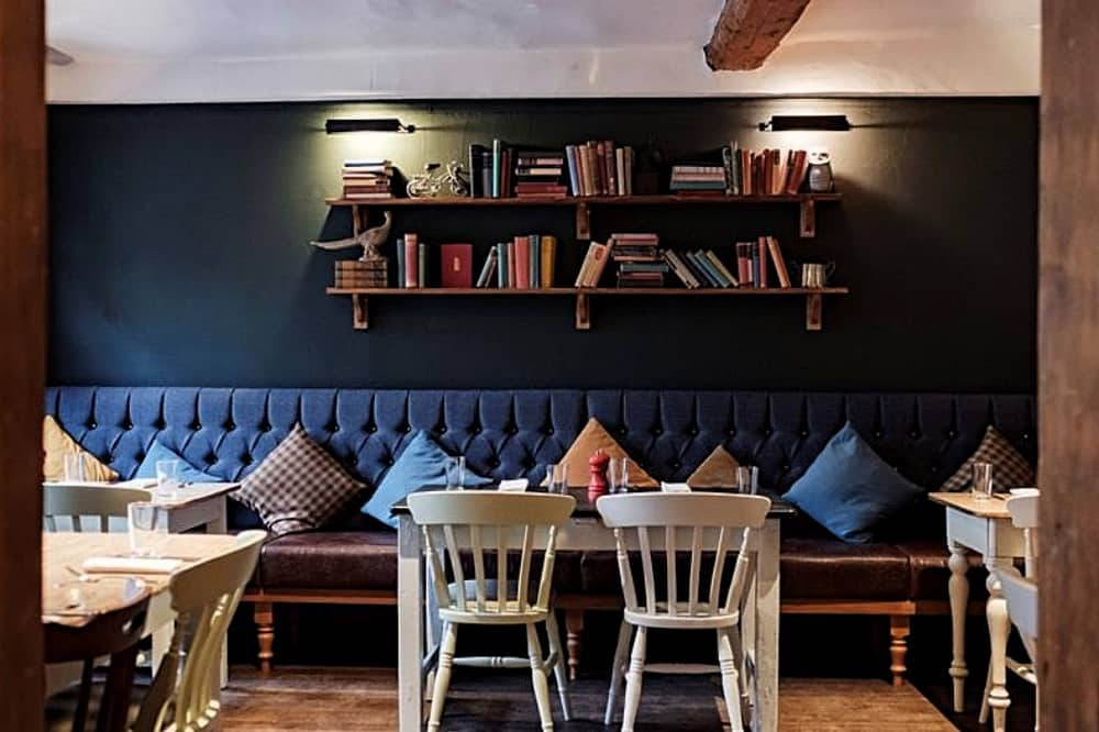 Bel and the dragon Windsor Dark blue dining room, blue tweed banquette and grey wooden chairs