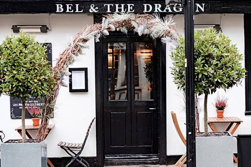 Cream and black exterior or Bel and the dragon Windsor . Bay tress and outside tables
