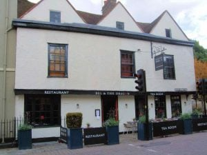 Historic black and white exterior of the 11th century inn , Bel & the Dragon in Windsor, Berkshire