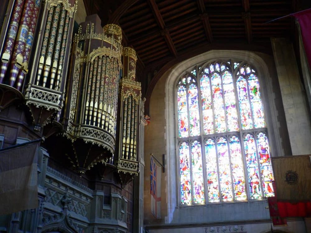 Stunning stained glass window and ornate brass organ pipes of Eton College Chapel Berkshire