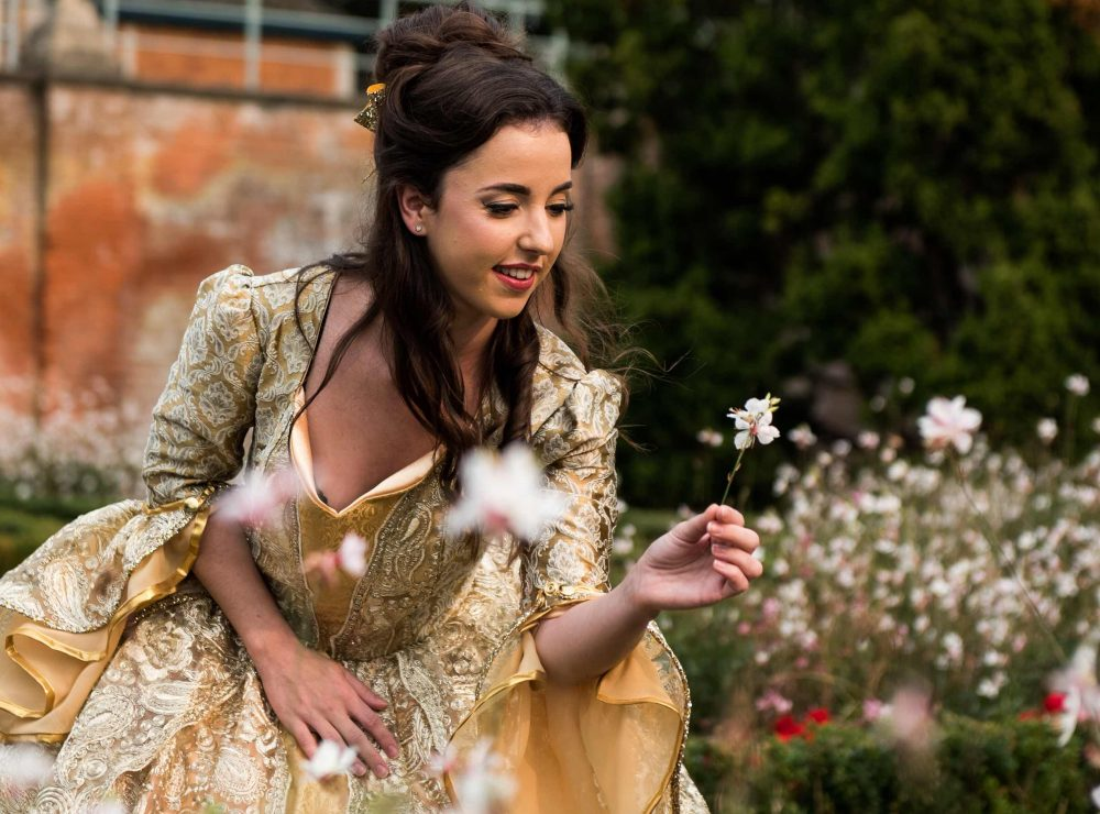 Actress Faye Ellen pictured wearing the infamous yellow Belle dress in the garden of South Hill Park Bracknell in Berkshire, ahead of her perforce in the panto Beauty and the Beast