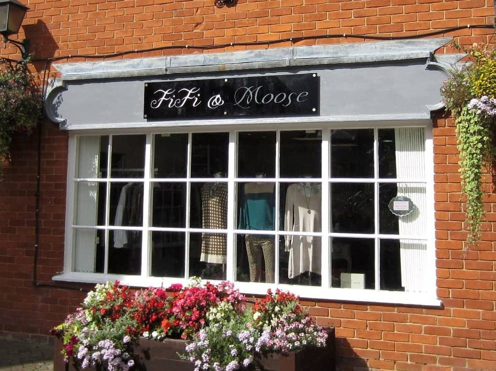 red brick exterior and half moon window of the fashion boutique Fifi and Moose Newbury