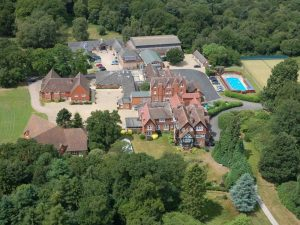 aerial view of Horris Hill Prep School – a collection of large red brick houses set in 85 acres of wooded heathland
