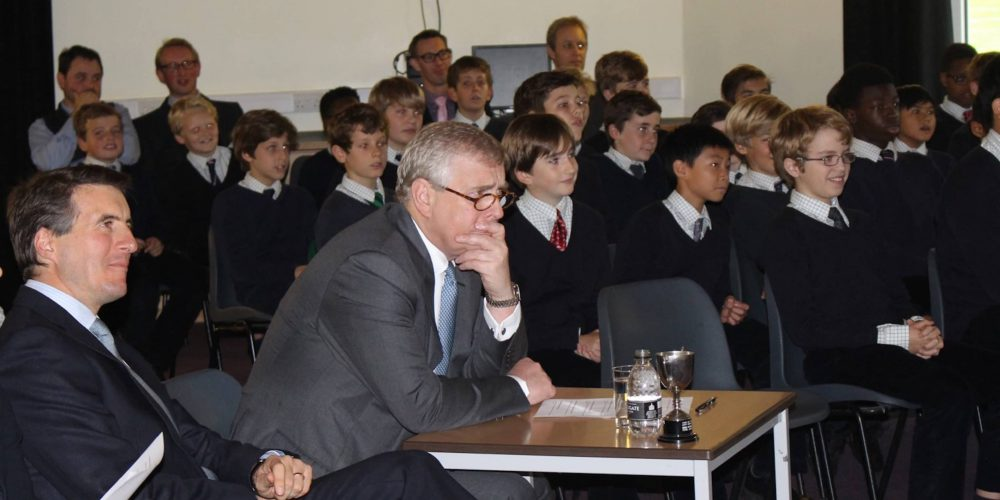 Duke Of York sits with Horris Hill headmaster Giles Tollit and pupils for Pitch Battle