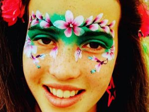 Festival face with painted flowers framing the eyes