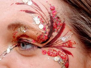 Flamboyant red and gold eyes painted to party
