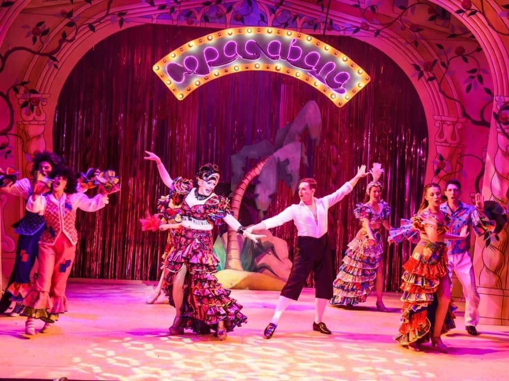 Barry Manilow's Copacabana in pink neon lights – panto dance routine at Corn Exchange Newbury